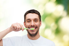 Smiling young man with toothbrush Royalty Free Stock Photography