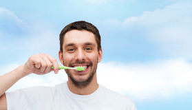 Smiling young man with toothbrush Royalty Free Stock Photo