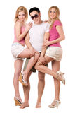 Smiling young man and two playful girls royalty free stock photography
