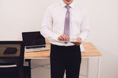 Smiling young man using digital tablet in the office.  Royalty Free Stock Images