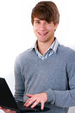 Smiling young man using laptop Stock Photos