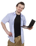 Smiling young man using laptop Stock Photo