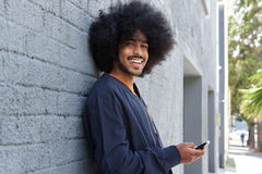 Smiling young man using phone stock photos