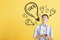 young man using smart phone and looking idea sign background royalty free stock images