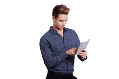 Smiling young man using tablet computer against a white background Stock Images