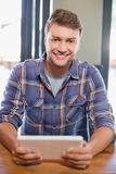 Smiling young man using tablet computer Royalty Free Stock Image