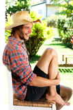 Smiling young man wearing cowboy hat outside Royalty Free Stock Images