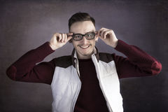 Smiling young man wearing glasses Stock Photos