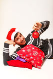 Smiling young man wearing Santa Claus hat Stock Photos