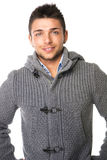 Smiling young man wearing winter sweater, isolated Stock Photos