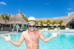 Smiling young man  welcoming you to the pool Stock Images