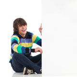 Smiling young man with white placard. Royalty Free Stock Images