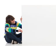Smiling young man with a white placard. Stock Photo