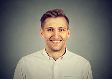 Smiling young man in white shirt royalty free stock photography