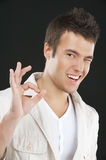 Young man to finger gesture OK Royalty Free Stock Image