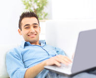 Smiling young man working Stock Images