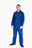 Smiling young mechanic in boiler suit Royalty Free Stock Image
