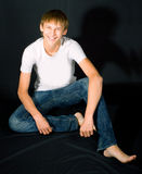 Smiling young men on black Royalty Free Stock Photo