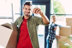 Couple with keys in new house Stock Photography