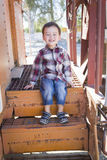 Smiling Young Mixed Race Boy Having Fun on Railroad Car Stock Photos