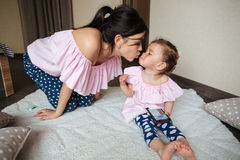 Smiling young mother with her little daughter Royalty Free Stock Photos