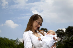 Smiling young mother holding her daughter Royalty Free Stock Photos