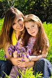 Smiling young mother with little daughter Royalty Free Stock Image