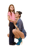 Smiling young mother and little daughter. Isolated Royalty Free Stock Photo
