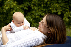 Smiling young mother playing with her daughter Royalty Free Stock Images