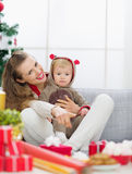 Smiling young mother spending Christmas with baby Royalty Free Stock Photo