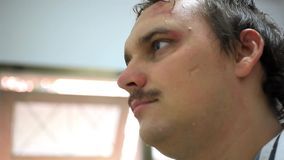 Smiling young moustached man in scars on face. HD stock footage