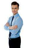 Smiling young natural executive. Executive standing isolated with folded hands and smiling at camera Stock Images