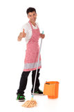 Smiling young Nepalese man, housework Stock Photo