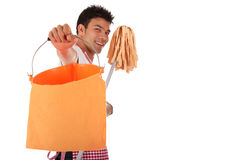 Smiling young Nepalese man, housework Royalty Free Stock Photography