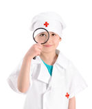Smiling young nurse with magnifying glass Stock Photo