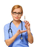 Smiling young nurse with syringe and stethoscope Stock Images