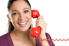 Smiling young operator with red phone Stock Photography