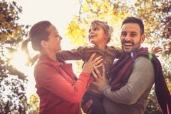 Smiling young parents walking with daughter. Stock Photography