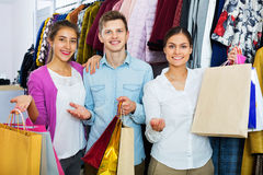 Smiling young people with purchases Stock Photo
