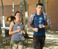 Smiling young people running outdoor stock photo