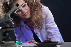 Smiling young physicist conducting experiment Stock Photo