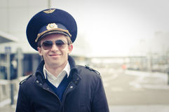Smiling young pilot in Kastrup airport Stock Photo