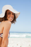 Smiling young posing in front of the camera on the beach Royalty Free Stock Image