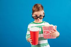 Smiling young preparing to watch film and looking over eyeglasses Royalty Free Stock Photos