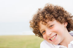 Smiling young pretty boy posing Stock Image