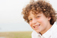 Smiling young pretty boy posing Royalty Free Stock Photography