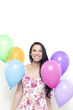 Smiling Young Pretty Brunette Woman holding Colorful Balloons on Stock Images