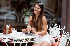 Smiling young pretty girl in cafe Stock Image