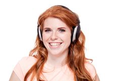 Smiling young redhead girl colorful shoppingbags Royalty Free Stock Photo