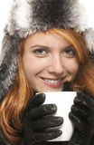 Smiling young redhead woman in winter dress holdin Stock Image
